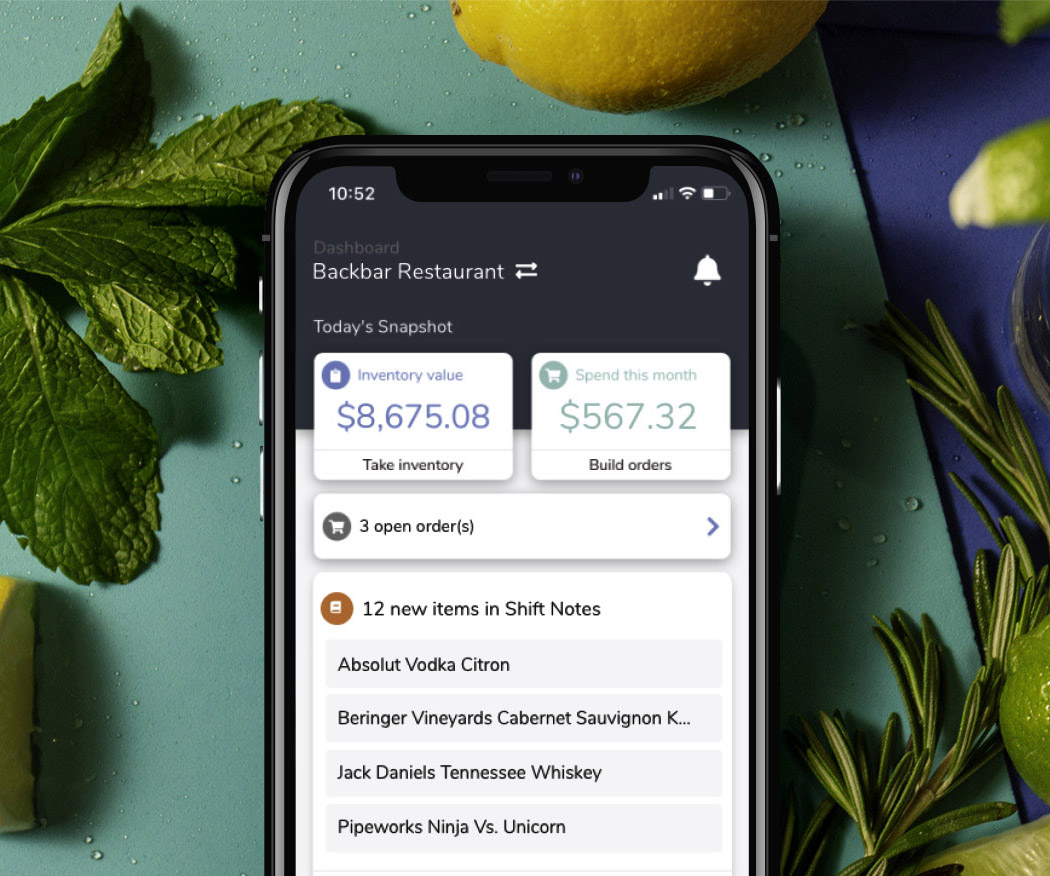 iPhone showing Backbar bar inventory app surrounded by herbs and citrus fruits, new homepage-1